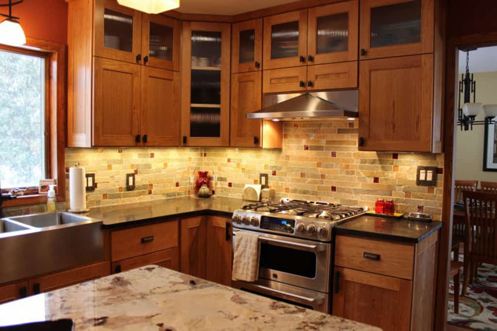 The natural cherry kitchen is near the heart of a house ...